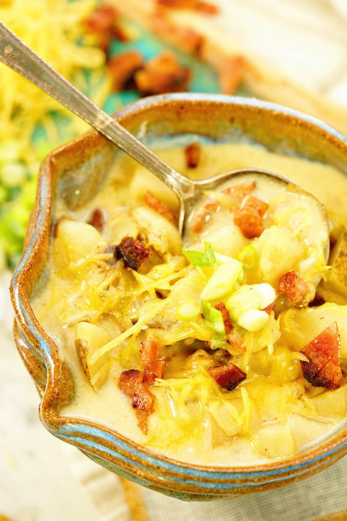 Loaded baked potato soup recipe topped with onions, cheese and bacon.