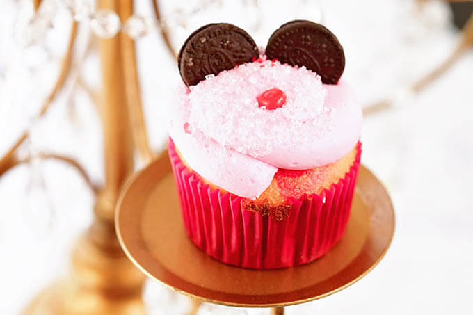Pink Minnie Mouse Cupcake with Oreo cookie ears and a little red nose.