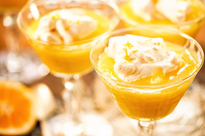 Lemon Curd served with whipped cream.