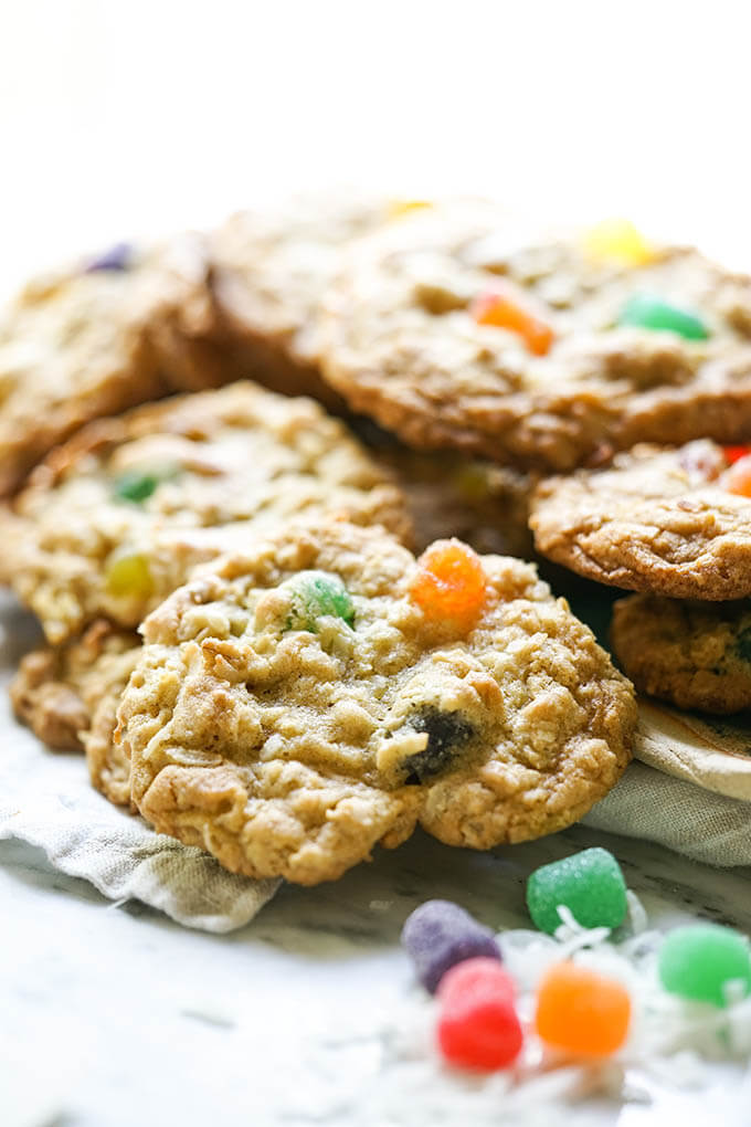 A stack of gumdrop cookies on white plate.
