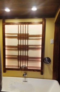 Cam's Custom Cabinets & Woodworking specializing in unique and personal orders. A shoji wall in a bedroom/bathroom suite