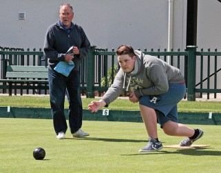 Don Descoteau/News Gazette staff April 24, 2016 -- Novice lawn bowler Jonathan Mantell follows through with style under the watchful eye of his grandfather, Paul Mansell, during an open house day at the Juan de Fuca Lawn Bowling Club at West Shore Parks and Recreation in Colwood. The fact Jonathan has curled at the Juan de Fuca club the past five winters meant he already had a good understanding of lawn bowling strategy before he stepped onto the green to practise his newfound sport.