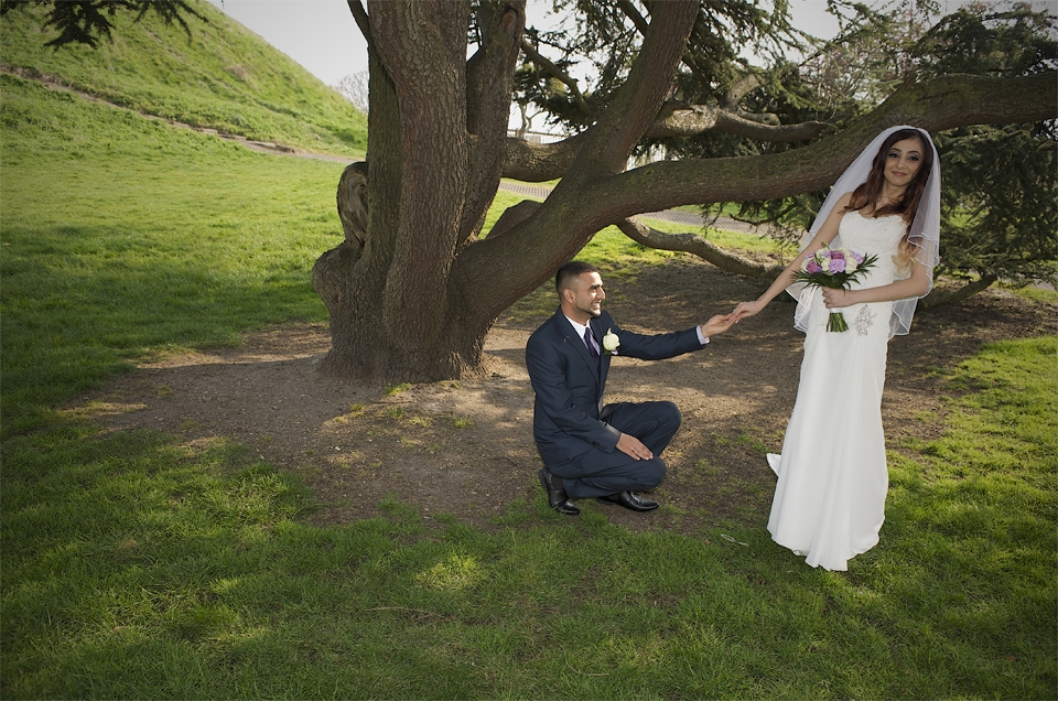 Adnan goes down on one knee during the wedding of Adnan and Jasmina by Cambridge photographer Richard Bowring