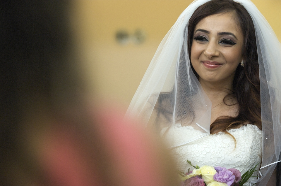 The bride Jasmina looking happy during the celebrations of her wedding by the cambridge based photographer Richard Bowring
