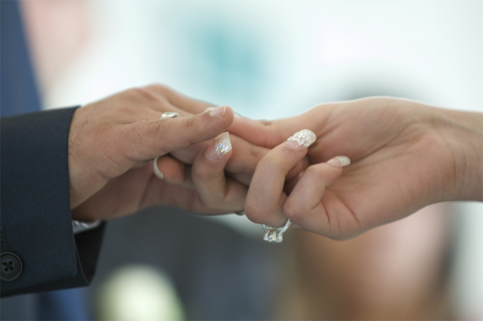 The bride and groom hold hands after the exchange of rings by cambridge photographer Richard Bowring