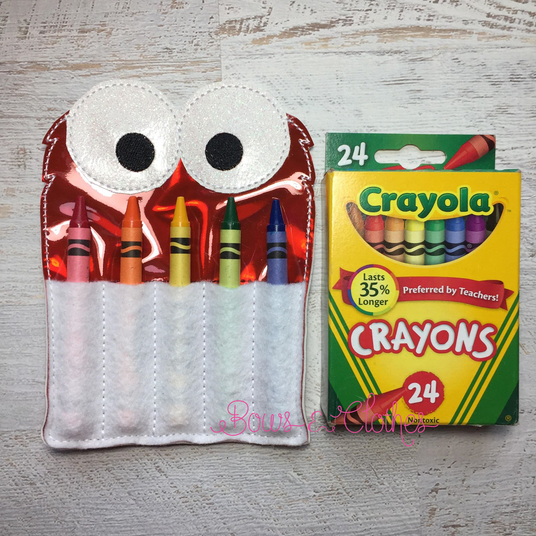 red monster crayon holder bows and clothes