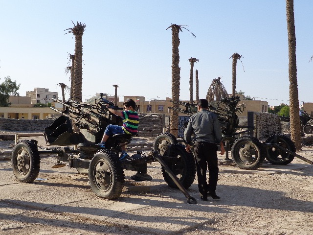 Children play with the artillery at the Holy Defense Museum