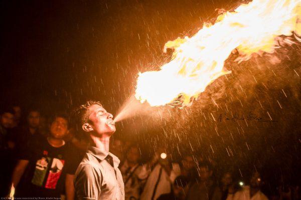 Guy breathing fire
