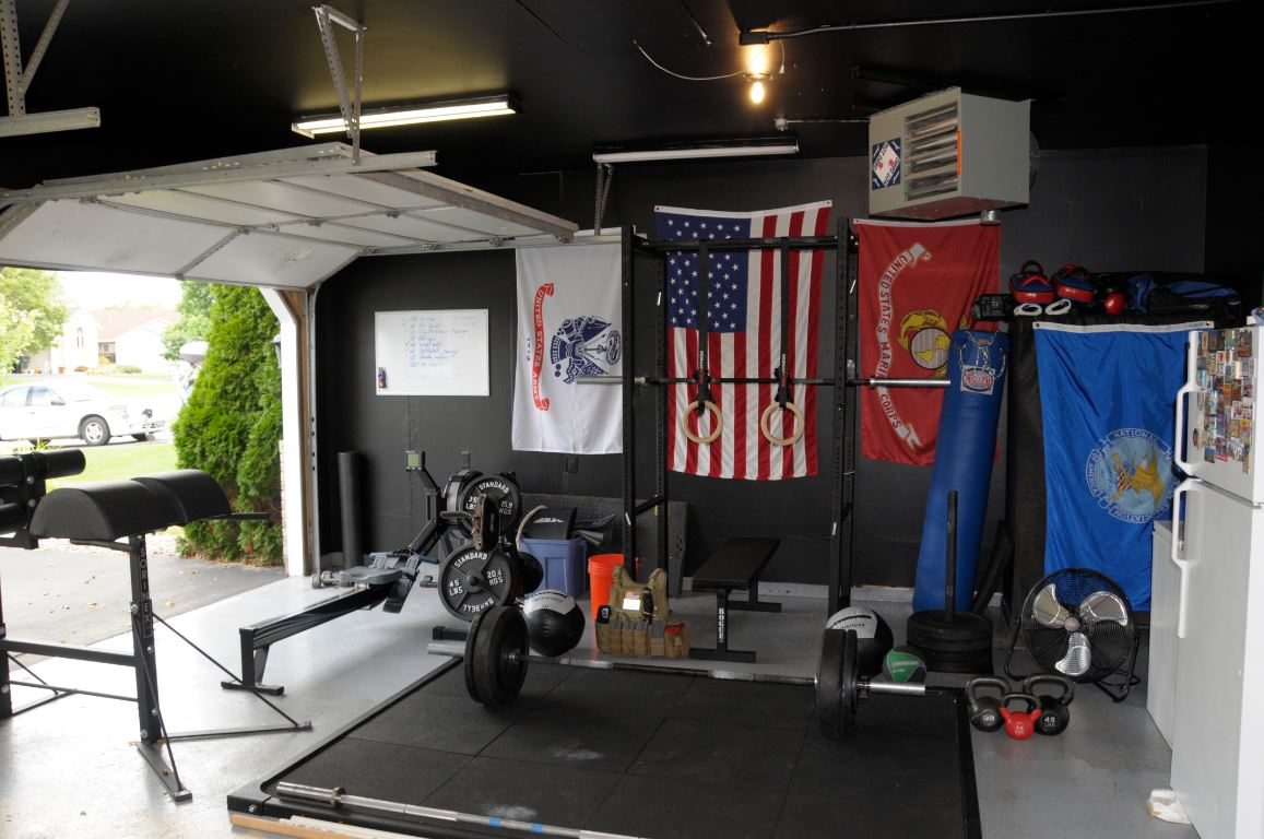 Crossfit garage setup with black walls