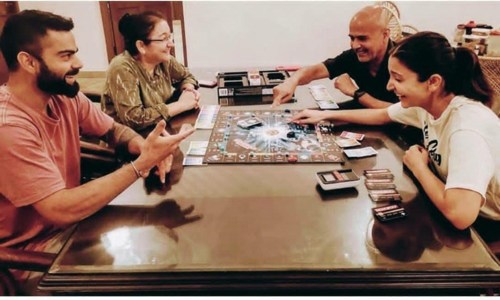 'Make the most of these moments' : Anushka Sharma shares pic of Virat and her parents playing boardgame, has some suggestions on how to use this quarantine to form deeper bonds with family