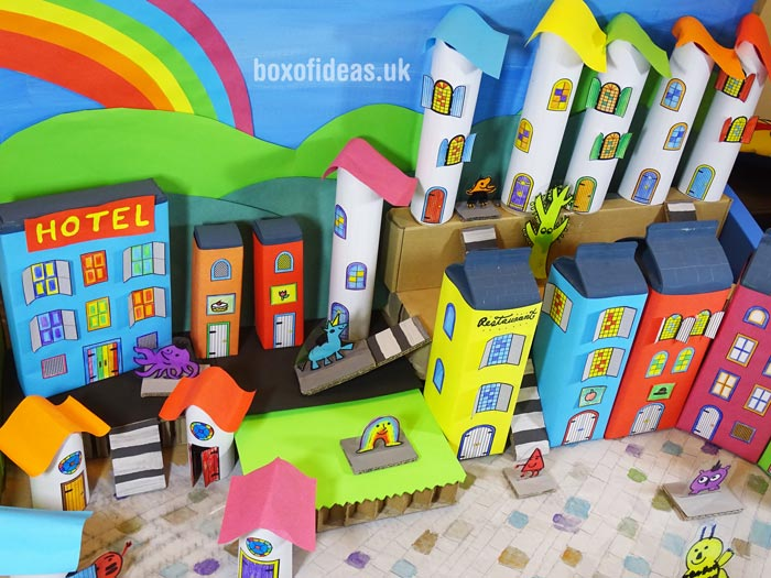 Colorful recycling craft buildings for a recycled town project. A fun DIY kids craft toy made out of recycling #recycling #kidscrafts #colorful