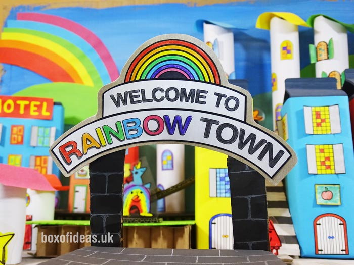 Welcome to Rainbow town sign for a recycled town project. A fun DIY kids craft toy made out of recycling #rainbows #kidscraft #papertown