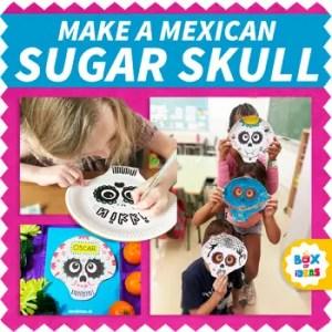 children making sugar skull masks on paper plates for day of the dead