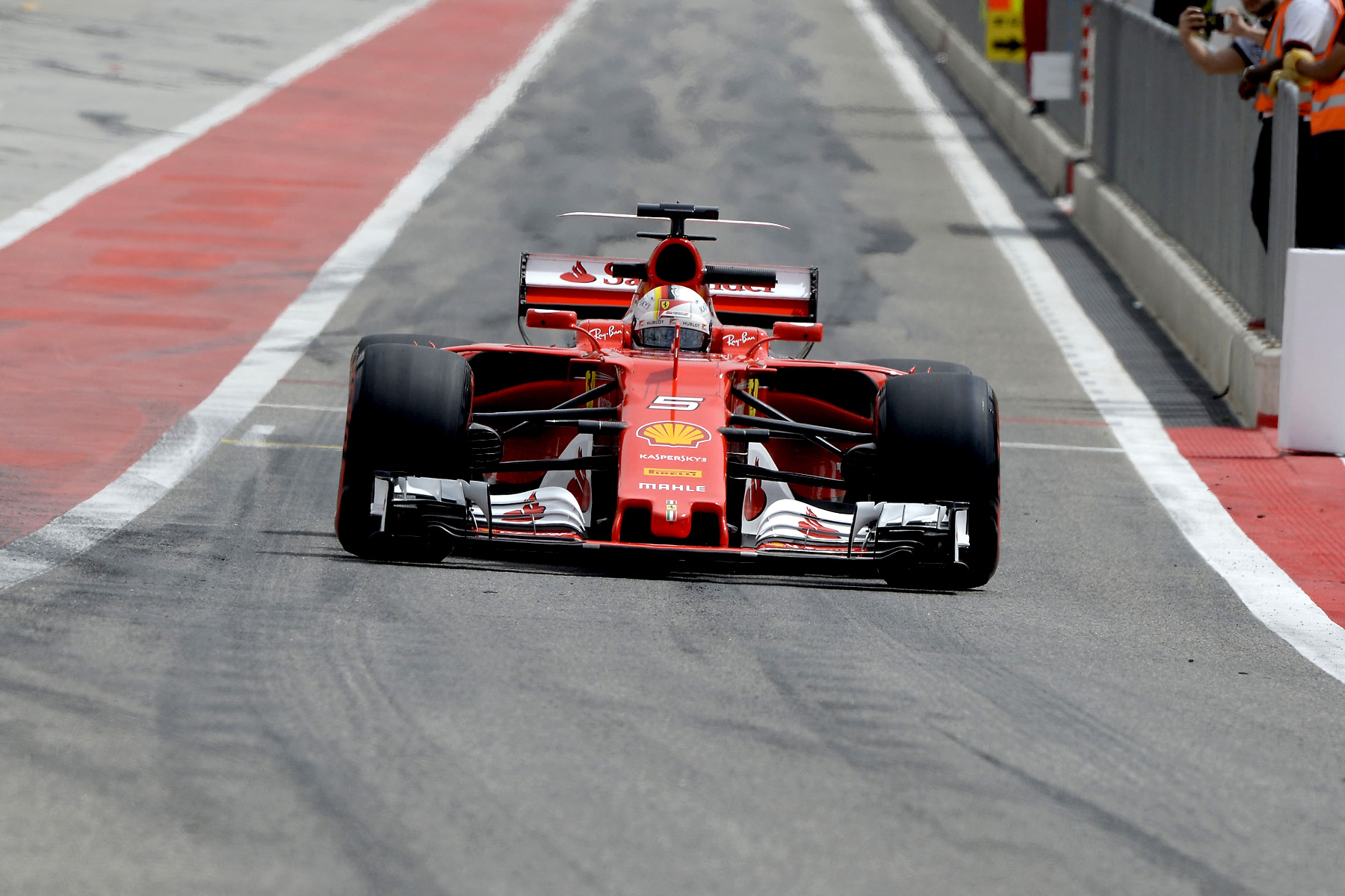 Ferrari's Sebastian Vettel drives down the pit lane during the Bahrain in-season test