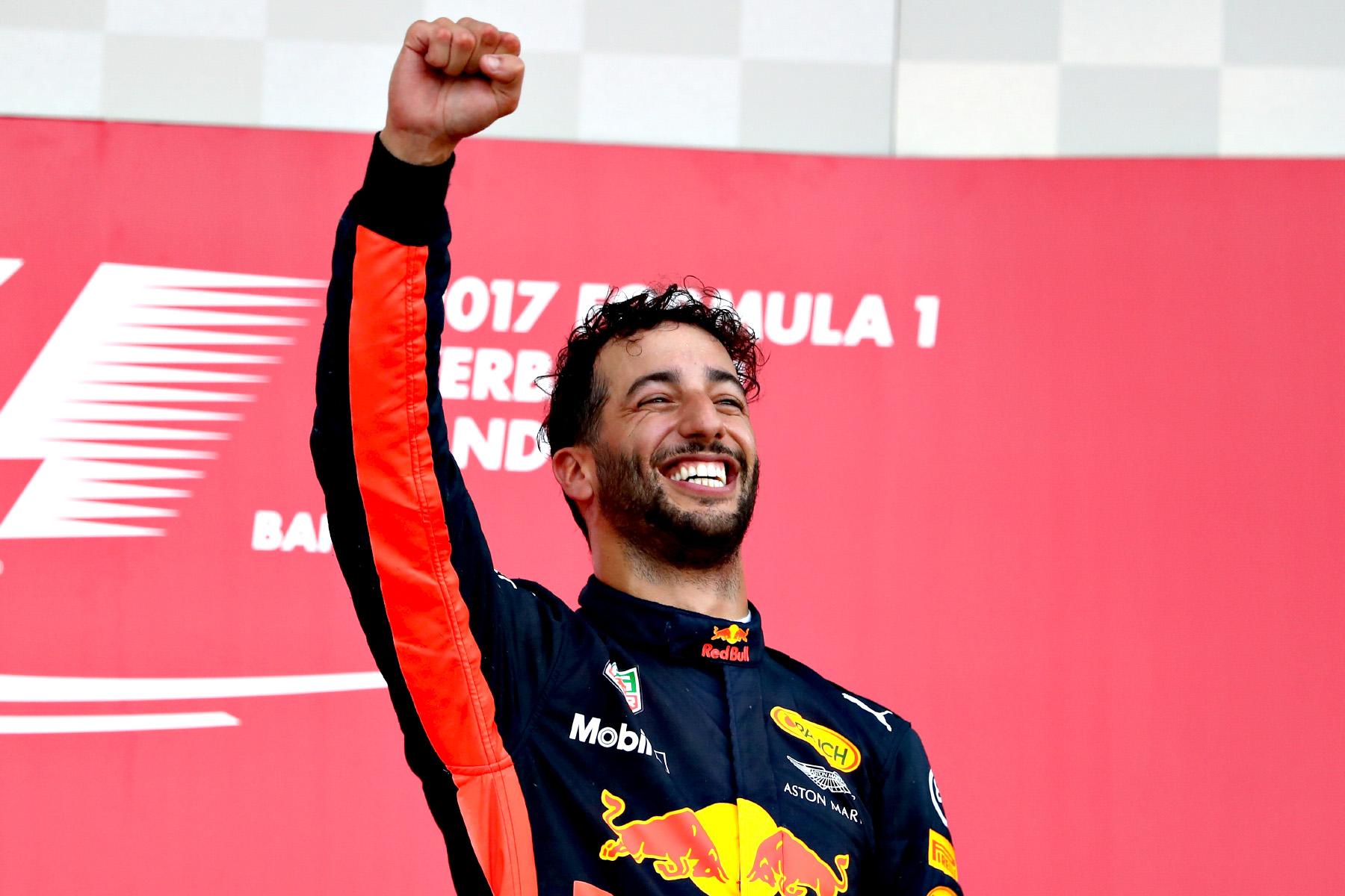 Daniel Ricciardo celebrates on the Azerbaijan Grand Prix podium