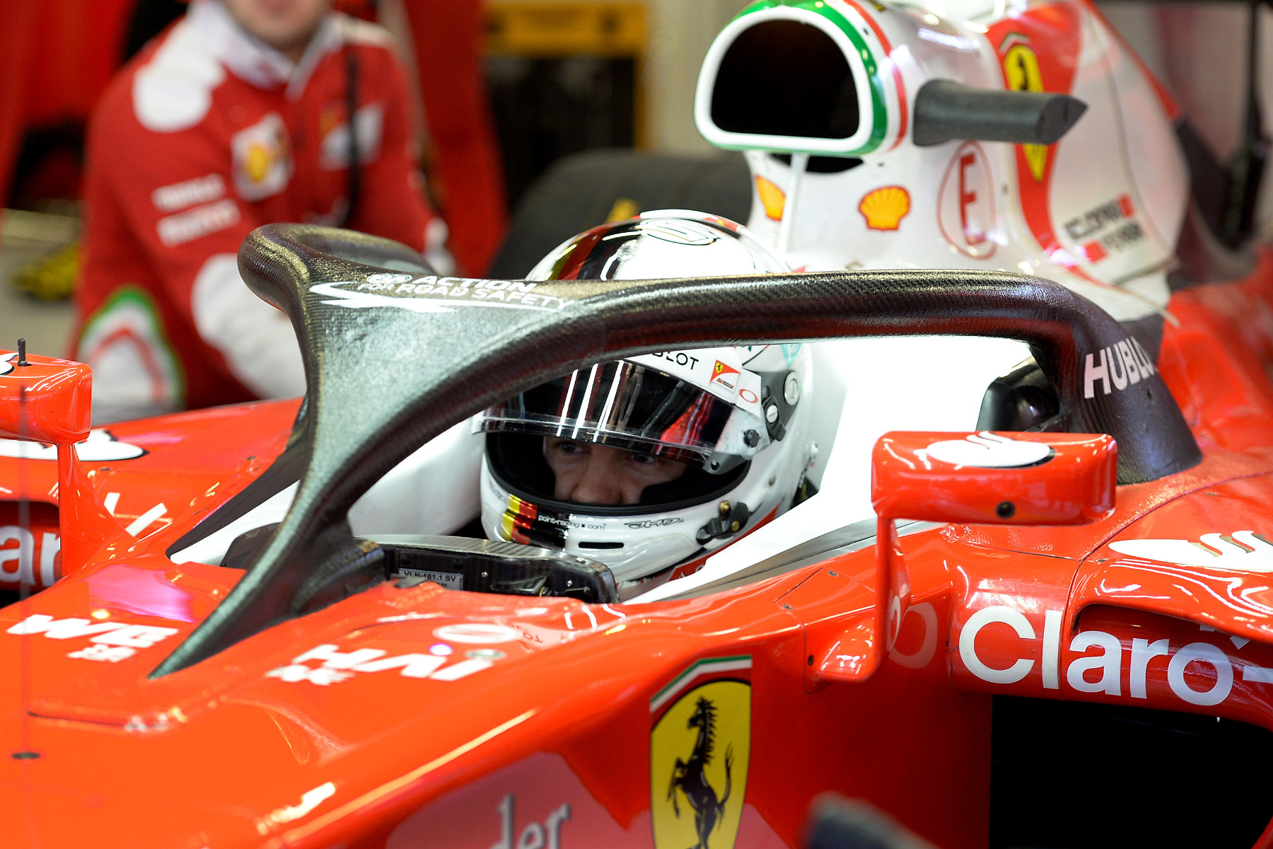 Sebastian Vettel sitting in his halo-fitted Ferrari during the 2016 preseason.