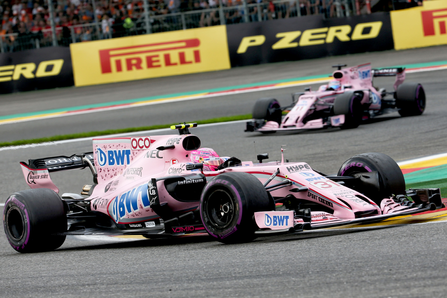 Esteban Ocon leads Force India teammate Sergio Perez at the 2017 Belgian Grand Prix.