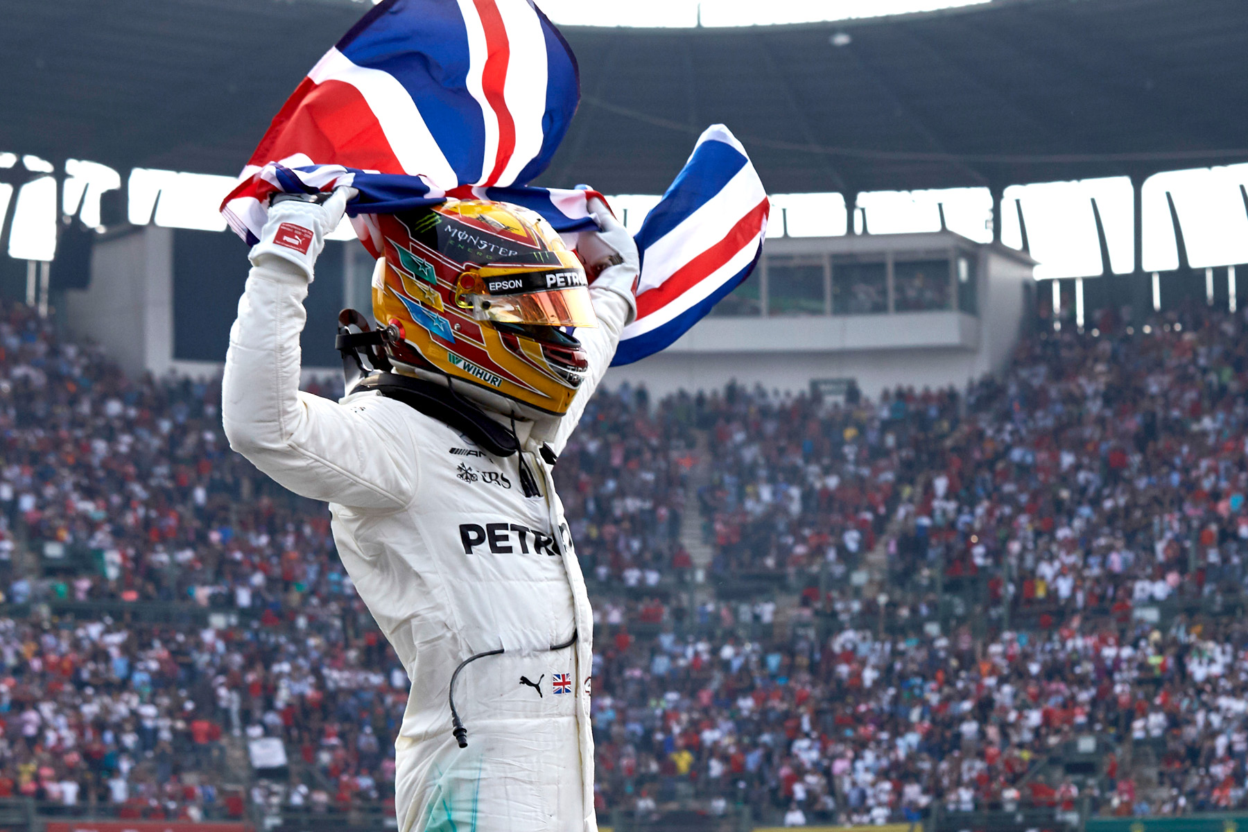Lewis Hamilton celebrates his fourth world championship at the end of the Mexican Grand Prix.