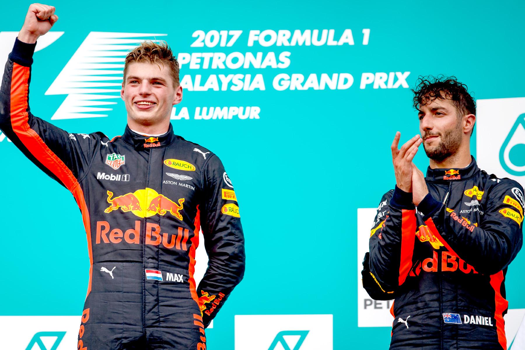 Max Verstappen and Daniel Ricciardo celebrate on the 2017 Malaysian Grand Prix podium.
