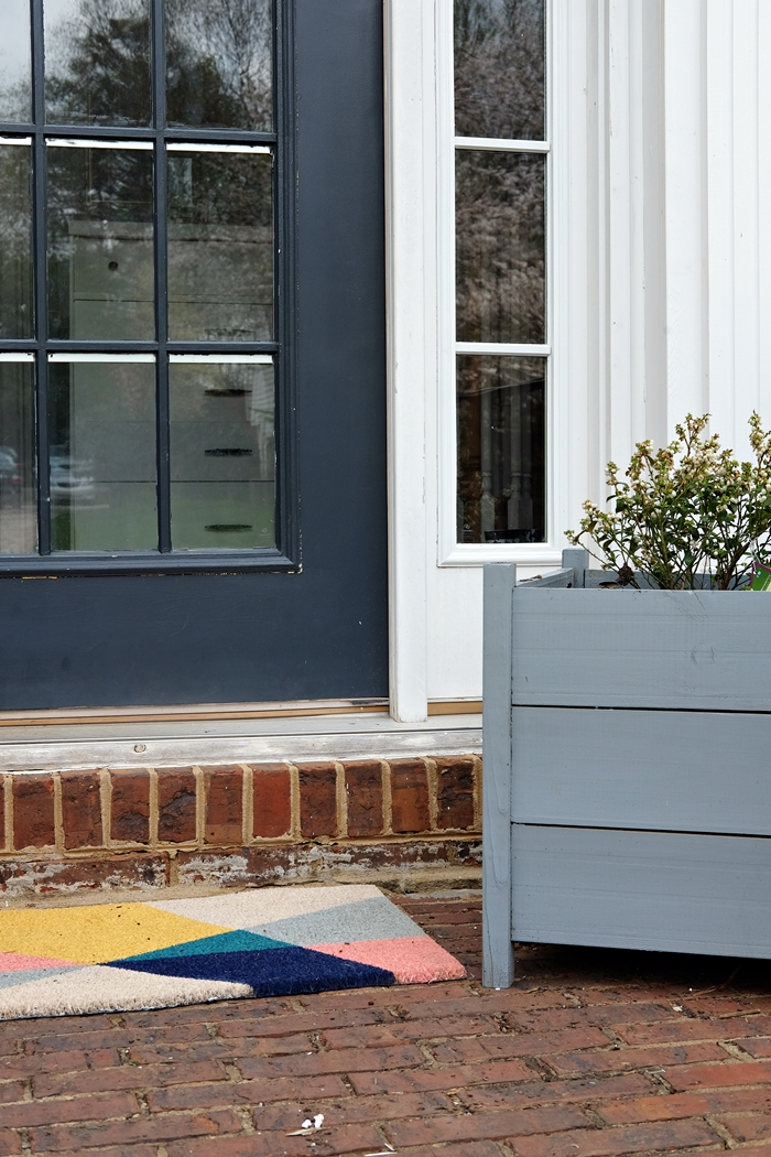 Boxy Colonial Spring Home Tour: front porch with new welcome mat from Target