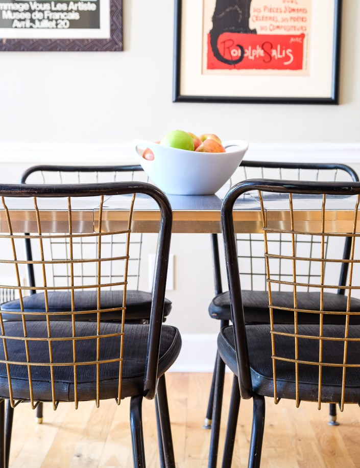 vintage black and gold chairs