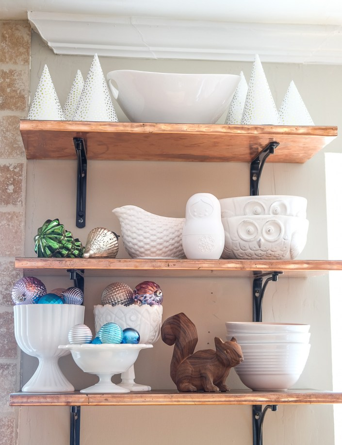 copper shelves decorated for Christmas