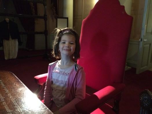 Rosie in Queen Victoria's chair.