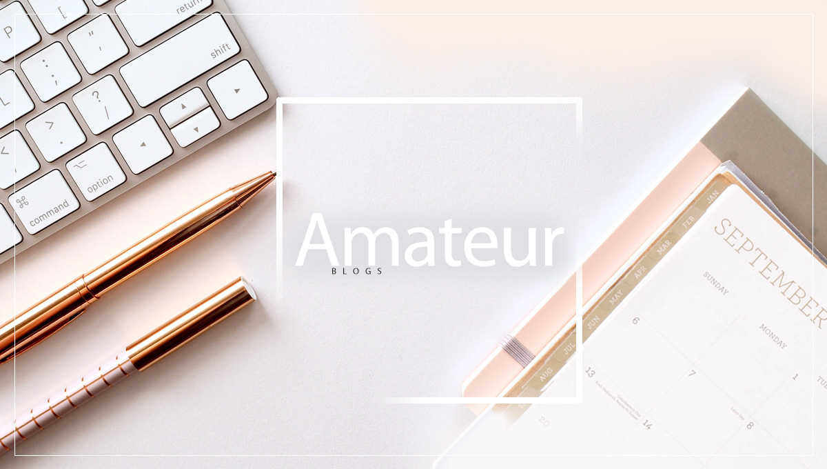 Golden pens with a golden keyboard and calendar with the inscription: Amateur Blogs