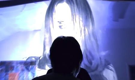 small woman in grey big ghost girl