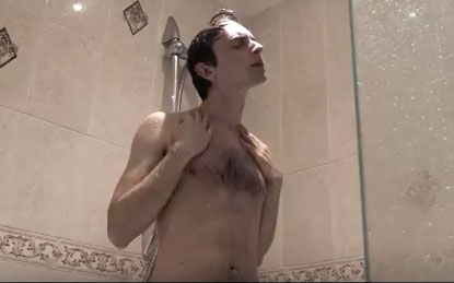 small woman in grey shower