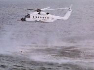 S-92 hovers over man in water