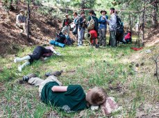 """Scouts assess the scene of a """"plane crash,"""" where """"injured"""" Scouts await their help."""