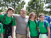 Les Stroud poses for a portrait with members of Venturing Crew 16.