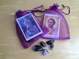 Each pouch contained 5 amethyst stones and wallet card. The pouches were at the altar all weekend, receiving the light of the masters.