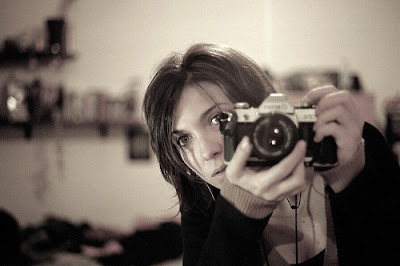 Greyscale self portrait of a photographer in a mirror