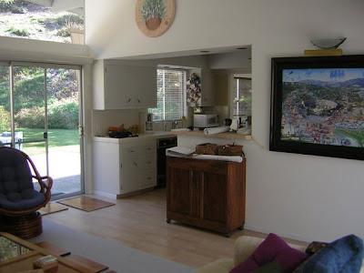 windows into the kitchen allows the light to flood the kitchen