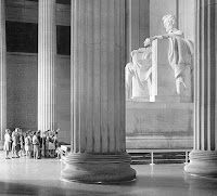 Statue of Abraham Lincoln in the Memorial with a bunch of 50's tourists looking on.
