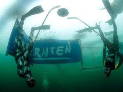 Underwater ice hockey