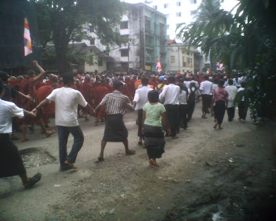 Monks protected by civilians