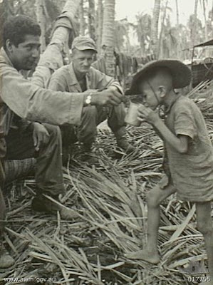 Philippines People Filipino Pinoy Pilipinas Old Black White Pictures evacuation leyte world war II WWII soldiers boy drinking noon