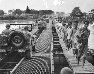 Philippines People Filipino Pinoy Pilipinas pictures photos Old Black White Pictures soldier crossing bridge pontoon river wwii jeepney 1945 noon