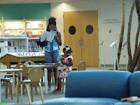 Mom reading with her daughter at the Library