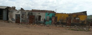 Destroyed buildings on the highway between Eldoret and Nakuru.