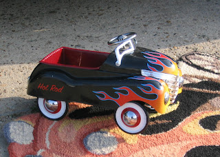 Toy replica of the large antique car