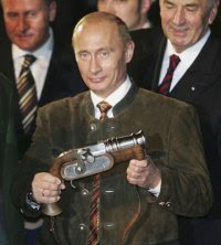 At the time Russian President, Vladimir Putin, wearing a typical Bavarian suit, holds a boeller gun in his hand on October 11, 2006 in Aying near Munich, Germany.