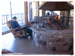 Relaxed moment beside Grebe Lodge's beautiful fire place, with views out over Georgian Bay.