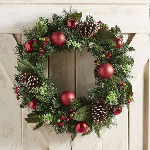 $90 BUY NOW This Christmas wreath from Pier 1radiates holiday joy. Adorned with red ornamentsand a mix of faux greenery, it displays a fabulously festive look. More:The Best Artificial Christmas Trees to Keep the Needles Off Your Carpet