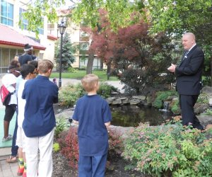 Greg Huber shows courtyard off and talks about special event rental business