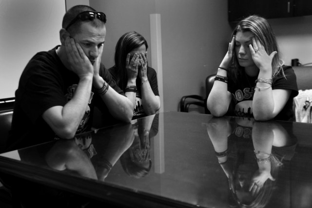 Family members of Marc Fucarile are devastated as Dr. Jeremy Goverman tells them in a conference room at the hospital that he may have to have his second leg amputated. l-r brother Edward Fucarile, sister Stephanie Baron, and fiancée Jen Regan.