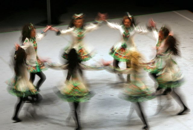 Boston-3/29/13-The Ryan-Kilcoyne School of Irish Dancing from Pennsylvania swirl on the stage during The World Irish Dancing Championships being held at the Hynes Convention Center.  It is only the second time in it's 40 year history that the eight-day event is held outside Ireland and Scotland. Organizers expect twenty-thousand people from around the globe to attend the event.